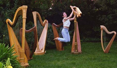 stephanie flying in a forest of harps